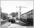Queensland State Archives 3471 South approach commencement of steel span No 6 stacked steelwork and crane runway in foreground Brisbane 30 April 1937.png