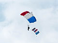 ROCA Dragon Team Crew with Military Flags of the Republic of China Descending over Military Academy Ground 20140531b.jpg
