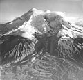 Redoubt Volcano, mountain glacier whose lower portion is largely covered in rocks and bergschrund on the upper portions (GLACIERS 6749).jpg