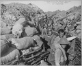 Repairing front line trench after bomb explosion fifty yards from enemy trenches. D. W. Griffith in civilian clothing. D - NARA - 533726.tif
