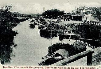 Xujiahui - A river scene, with the mission and observatory,  at Zikawei in c. 1920
