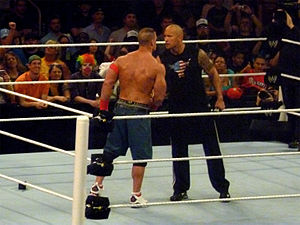 WrestleMania XXVIII - John Cena (left) and The Rock (right) agree to fight at WrestleMania XXVIII