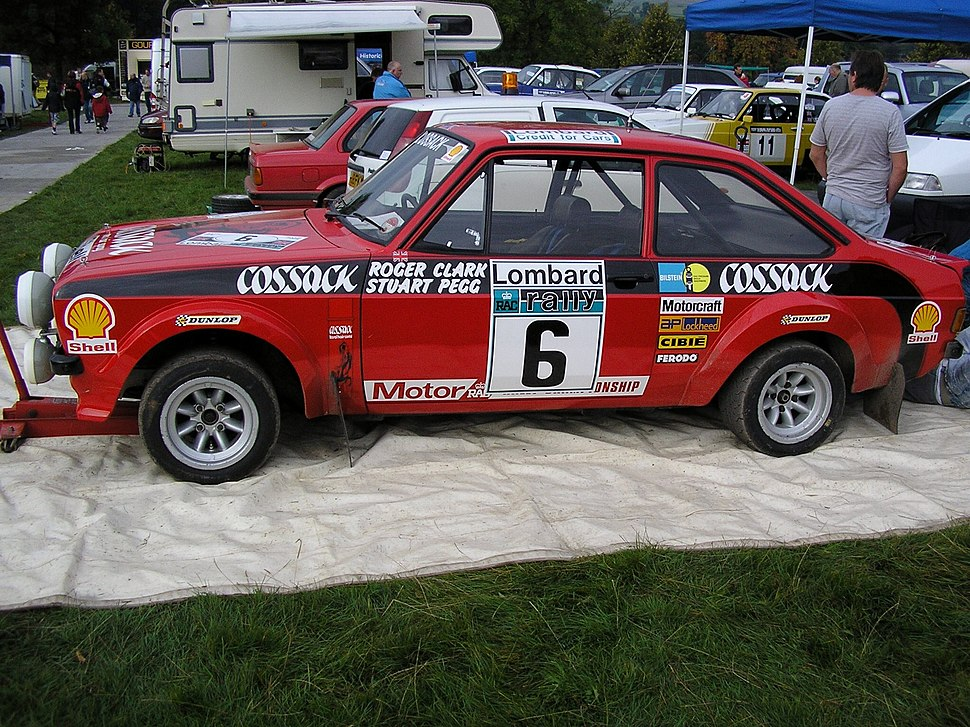 Roger Clark%27s Cossack sponsored Ford Escort RS1800, winner of the 1976 Lombard RAC Rally, pictured at the 2008 Rally Fest at Chatsworth House 2013-12-07 09-06