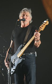 Roger Waters playing bass and singing.