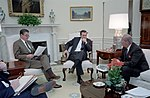 Ronald Reagan at a National Security Briefing with Donald Rumsfeld and George Shultz in Oval Office.jpg