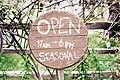 Round wooden open sign.jpg