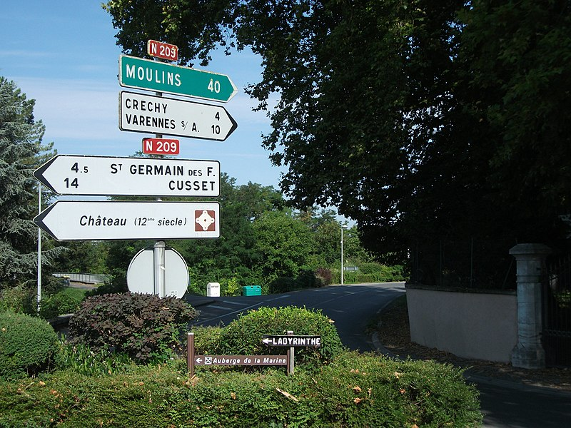 Road towards Moulins in Billy, France. Directional road signs made in 1986 [8579]