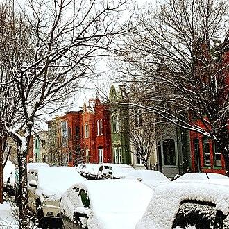U Street - Row houses after snowfall on Wallach Place