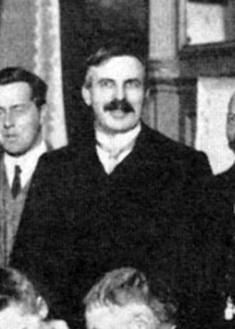 Proton - Ernest Rutherford at the first Solvay Conference, 1911