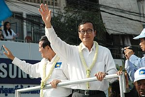 2013–14 Cambodian protests - Image: Sam Rainsy and Kem Sokha wave to protesters