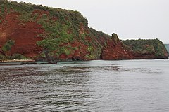 Red scoria cliffs at Akyia-kaigan coast in the Oki Islands, Japan. It was erupted 2.8 million years ago.