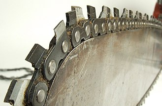 """Saw chain - A section of """"scratcher"""" chain on a bar nose, showing the tooth layout."""
