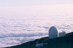 A sea of clouds below the William Herschel Telescope.