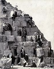 Several people gathered at the base of the Great Pyramid.jpg