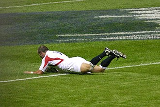 Try - Shaun Perry scoring a try for England against the All Blacks