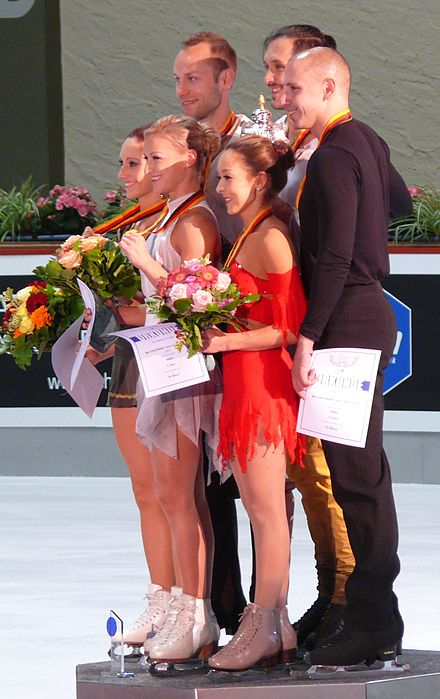 The Wendes, Volosozhar / Trankov, and Vartmann / Van Cleave stand on the pairs' podium