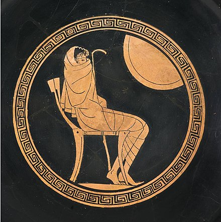Sitting Achilles wrapped in a himation, depicted on a greek kylix from ca 500 BC.