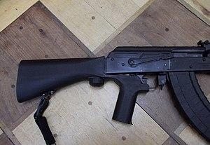 Bump fire - A Slidefire bump fire stock on a WASR-10 rifle