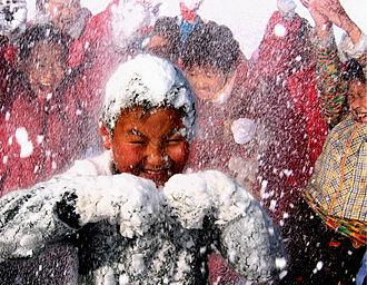 Fun - Children having fun playing with snow