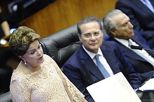 Impeachment of Dilma Rousseff -  Rousseff speaking at her presidential inauguration to a joint session of the National Congress, 1 January 2015. Behind her are Senate president Renan Calheiros, and Vice President Michel Temer.