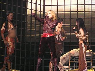 "Sorry (Madonna song) - Madonna, flanked by her dancers, performing ""Sorry"" on the Confessions Tour"