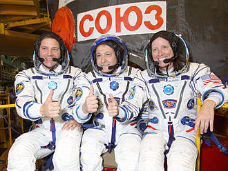 Soyuz TMA-19 Crew (Walker on the right) prior to launch. Soyuz TMA-19 Crew in front of the capsule (closeup).jpg