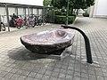 Steinbrunnen bei Kirche St. Peter und Paul 02.jpg