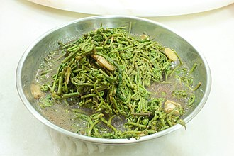 """Stenochlaena palustris - A plate of stir-fried """"Midin"""" together with ginger in Sarawak."""