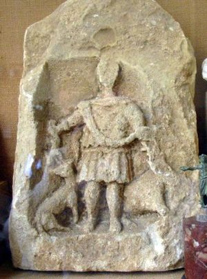 Chedworth Roman Villa - Stone carving of a hunter with a dog and stag