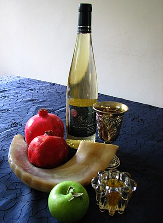 Jewish holidays - Rosh Hashana symbols: shofar, apples and honey, pomegranates, kiddush wine
