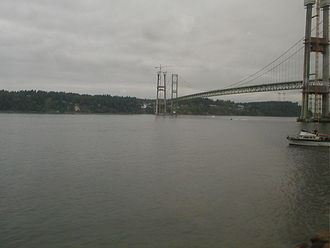 Tacoma Narrows - The Tacoma Narrows as viewed from Tacoma, facing northwest towards the Kitsap Peninsula. The towers for the 2007 Tacoma Narrows Bridge are under construction in this photograph; the 1950 Tacoma Narrows Bridge is to the right of the new bridge construction. (2005)