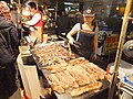 Taiwan Aborigine Roast Pork and Millet Wine Seller in Miaokou Night Market 20120205b.JPG