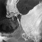 Taku and Norris Glaciers, terminus of tidewater glaciers seperated by braided streams, August 24, 1963 (GLACIERS 6129).jpg