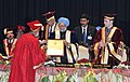 The Prime Minister, Dr. Manmohan Singh felicitating the DG of ICAR, Shri S. Ayyappan, at the 3rd Convocation of Sher-e-Kashmir University of Agricultural Sciences and Technology, in Jammu on March 04, 2011.jpg
