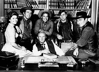 The Virginian (TV series) - The main cast in the fall of 1964: Center: Lee J. Cobb (Judge Garth). From left: Roberta Shore (Betsy Garth), Clu Gulager (Emmett Ryker), Doug McClure (Trampas), Randy Boone (ranch hand), James Drury (the Virginian)