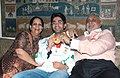 The first winner of an individual Gold Medal for India at the Beijing Olympic Games and International Shooting Ace, Shri Abhinav Bindra showing the Gold Medal on his arrival at Delhi Airport along with his parents (father.jpg
