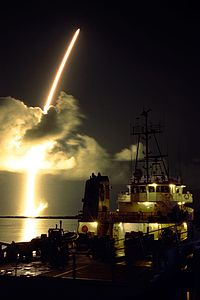 Titan IV with Cassini-Huygens launches with Liberty Star vessel in foreground.jpg