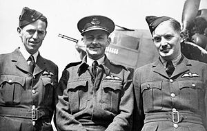 "Leonard Henry Trent - Squadron Leader Trent, left, with Wing Commander G J ""Chopper"" Grindell, centre, Commanding Officer of No. 487 Squadron RNZAF, and Squadron Leader T Turnbull, 1943"