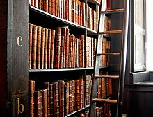220px-Trinity_College_Library-words_in_leather_and_wood