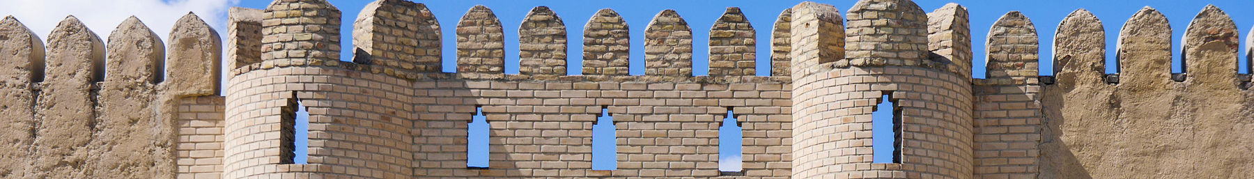 Turkistan banner Outer walls of the tomb yard.jpg