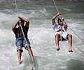 Two men crossing the River Beas in Manali in 2009.jpg