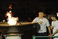 U.S. Air Force Airman Joshua Gonzalez, left, assigned to the 81st Security Forces Squadron, and athlete Tony Gamberi light the cauldron during opening ceremonies for the 2010 Mississippi Special Olympic games at 100515-F-BD983-004.jpg