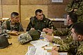 U.S. Army Lt. Col. Javier Garcia, left, the commander of a security force advise and assist team with the 2nd Cavalry Regiment, conducts a key leader engagement with a Romanian soldier, center, and a Georgian 130309-A-OY175-002.jpg