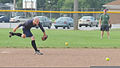 U.S. Coast Guard Petty Officer 3rd Class Christopher Yaw, a public affairs specialist with the 9th Coast Guard District External Affairs Office in Cleveland, runs to field a ground ball during his unit's 130731-G-KB946-007.jpg
