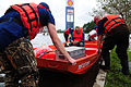 U.S. Coast Guardsmen with the Disaster Assistance Response Team perform a medical evacuation along a flooded frontage road by the Highway 55 underpass in La Place, La., Aug. 31, 2012 120831-G-LB304-025.jpg