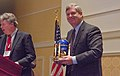 U.S. Department of Agriculture Secretary Tom Vilsack smiles after Biofuels Digest Publisher and Editor Jim Lane presented him with the Global Biofuels Leadership Award for bringing food, fiber, feed and fuel for all.jpg
