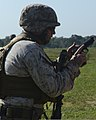 U.S. Marine Corps Sgt. Maj. David Daveny prepares his M9 service pistol before a course of fire during the Quantico Combat Shooting Match at Weapons Training Battalion (WTB) on Marine Corps Base Quantico, Va 130530-M-DG271-001.jpg