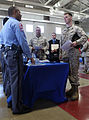 U.S. Marine Corps Sgt. Todd Davis, a drill instructor with Service Battalion, speaks to a representative from the Raleigh Police Department for information on career opportunities with the police department 130416-M-EK666-005.jpg