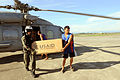 U.S. Navy Aviation Warfare Systems Operator 2nd Class Slavek Glownia and villager move humanitarian supplies from an SH-60F Seahawk helicopter in Kalibo, Philippines, July 1, 2008 080701-N-HX866-006.jpg