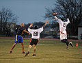 U.S. Navy Lt. Cmdr. Alex Hampton, left, a student at the U.S. Naval War College (NWC), passes the ball during an Army-Navy flag football game at Nimitz Field at Naval Station Newport in Newport, R.I., Dec. 6 131206-N-PX557-288.jpg
